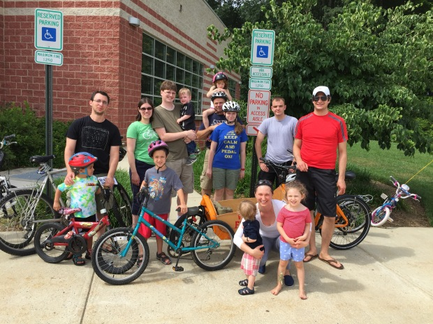 Children and adults gathered for the first Kidical Mass ride with bicycles in front of Thomas Farm Community Center